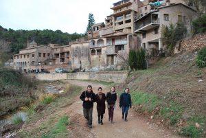 "Town of Mura with ""Els Caus de Mura"" cooperative behind"